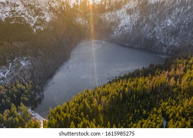 Cerne jezero in the Bohemian Forest is the largest and deepest natural lake in the Czech Republic. This triangular lake surrounded with spruce forest is located about 6 km northwest of Zelezna Ruda. - Shutterstock ID 1615985275