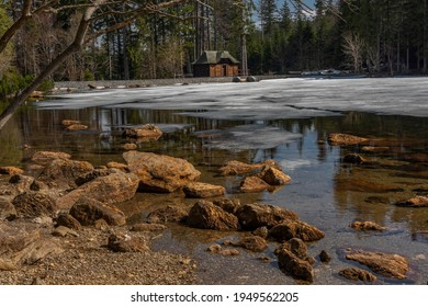 Cerne lake in national park Sumava in south west Bohemia in spring sunny cold day - Shutterstock ID 1949562205