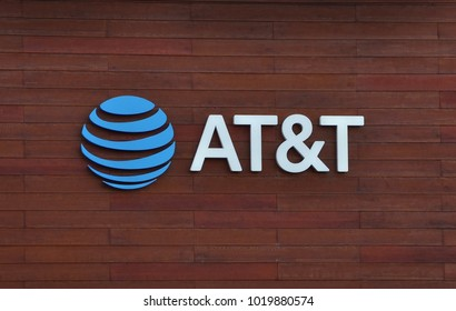 Cerritos, California - January 15, 2018: Sign of AT&T posted in a wooden wall.