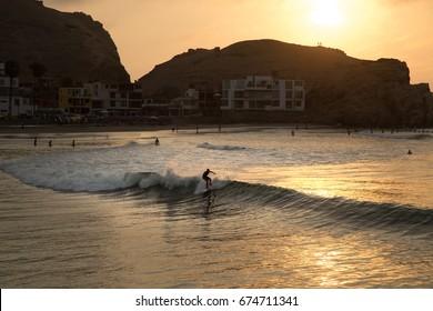 CERRO AZUL, LIMA, PERU: Surf at the sunset.