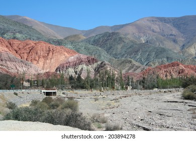 Cerro de los Siete Colores (The Hill of Seven Colors) behind Purmamarca village, in the colorful valley of Quebrada de Humahuaca in Jujuy Province near Salta in northern Argentina.