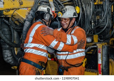 Cerro de Pasco, Peru - July 13th 2017: Miners in the mine. Miners inside the mine greeting each other.