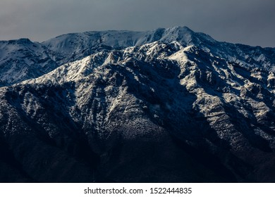 Cerro Ramon and Cerro La Cruz summits during a winter day. Snowcapped summits at central Andes mountains and amazing snowy rugged landscape on a cloudy day, an awe outdoor winter background scenery