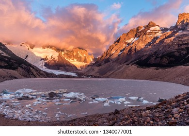 Cerro Torre coming out from the dramatic morning clouds at Laguna Torre. Los Glaciares National Park, Argentina