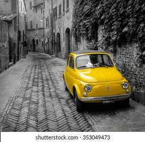Certaldo, Italy - 15 September 2013: 500 car is a symbol of the italian car industry.  This photo was taken in the medieval city of Certaldo, Toscany, Italy.