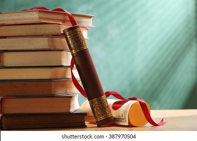 certificate holder lean on stack of  book