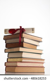 certificate on top of stack of books