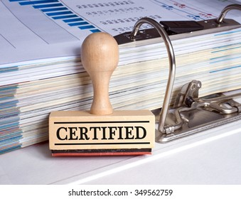 Certified - rubber stamp with binder in the office