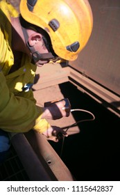 Certifies construction miner officer conducting gas testing atmosphere inside the confined space chute at the entry point mining site Pilbara region, Perth Western  of Australia