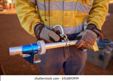 Certifies worker inspector inspecting industry fall arrest, fall restraint industry fall protection beam clamp safety hook prior to used construction site, Sydney, Australia