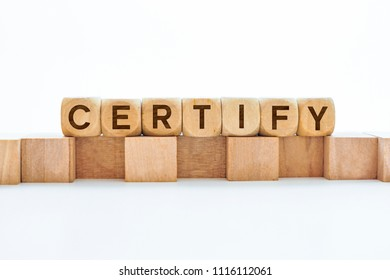 Certify word on wooden cubes