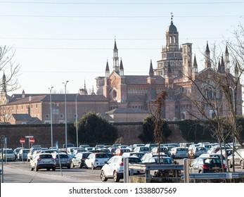 CERTOSA DI PAVIA, ITALY - FEBRUARY 22, 2019: Certosa di Pavia Gra-Car (Carthusian Monastery, Monastero di Santa Maria delle Grazie) and parking area near raiway station of Certosa di Pavia town