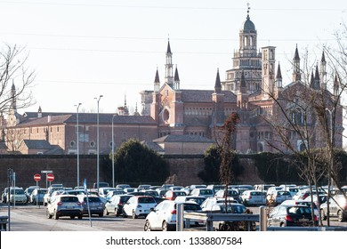 CERTOSA DI PAVIA, ITALY - FEBRUARY 22, 2019: view of Certosa di Pavia Gra-Car (Carthusian Monastery, Monastero di Santa Maria delle Grazie) from parking area near Certosa di Pavia town raiway station