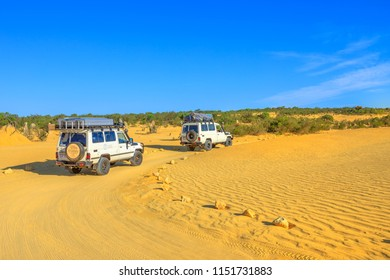 Cervantes, Australia - Dec 22, 2017: Toyota Land Cruiser four-wheel-drive jeeps running on the Pinnacles Drive, in Pinnacles Desert, Nambung National Park, Western Australia.