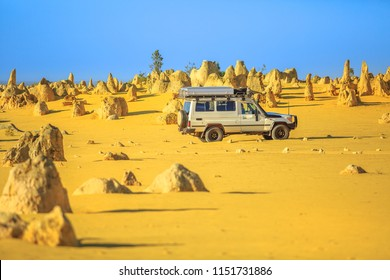 Cervantes, Australia - Dec 22, 2017: Four-wheel-drive car on Pinnacles Drive, dirt road in Pinnacles Desert, Nambung National Park, Western Australia. Discovery and adventure travel concept.
