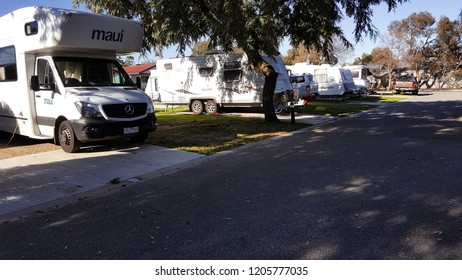 Cervantes, Western Australia - 2 September 2017 : Motorhomes and caravans are parked at a camping site in RAC Cervantes, showing the popularity of the road trip and camping tourism in spring.