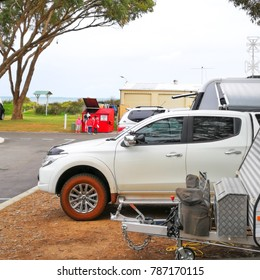 Cervantes, Western Australia - September 2, 2017 : Four wheel drive attached to a caravan is parked at a camping site in RAC Cervantes,
