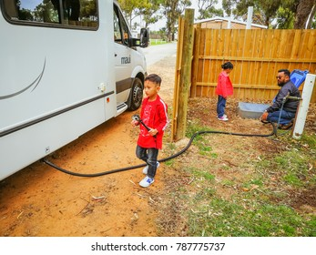 Cervantes, Western Australia - September 2, 2017 : An asian family is dumping out the waste water into the dumping hole at a camping site in RAC Cervantes,