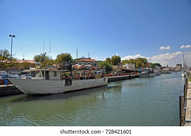 CERVIA, ITALY- AUGUST 25, 2016: fishing boats in the old village fishing harbor.