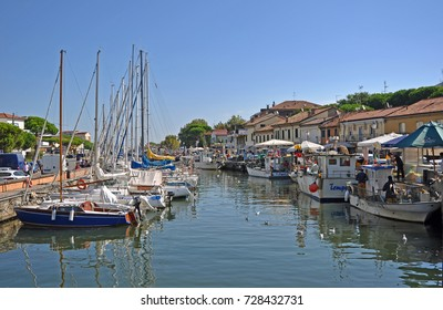 CERVIA, ITALY- AUGUST 25, 2016: boats in the old village fishing harbor.