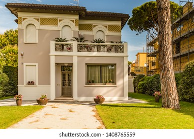 CERVIA (RA), ITALY - MAY 17, 2019: sunlight is enlightening house in historical center of Cervia