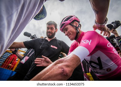 Cervinia, Italy 26 May 2018: Chris Froome, in pink jersey, attacked by journalists and photografers after the last montain stage of Tour of Italy 2018, is accompanied to the podium of the awards.