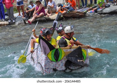 CESANA, ITALY - JULY 06, 2014: Carton Rapid Race is an amateur sport competition for ships made of cardobard on Dora Riparia river