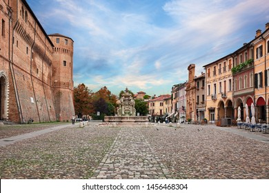 Cesena, Emilia-Romagna, Italy: landscape of the ancient square Piazza del Popolo with the fortified palace Rocchetta di Piazza and the fountain Fontana del Masini in the old town of the city