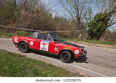 Cesena, Italy - April 8, 2018: driver and co-driver on a vintage racing car Fiat 124 Abarth running in 12th Rally della Romagna