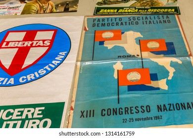 CESENA, ITALY - JANUARY 20, 2019: lights are enlightening advertising banners of Italian political parties for sale in Antiques Fair