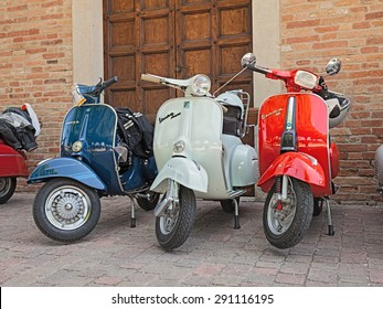 "CESENA, ITALY - JUNE 2: three vintage Italian scooters Vespa in classic car and motorcycle rally ""Attraverso le centurie romane"" on June 2, 2015 in Cesena, Italy"