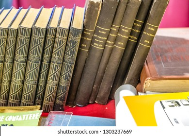 CESENA, ITALY - NOVEMBER 18, 2018: lights are enlightening old books for sale in Antiques Fair, in particulare Writing and Speeches of Benito Mussolini and Musee des familles