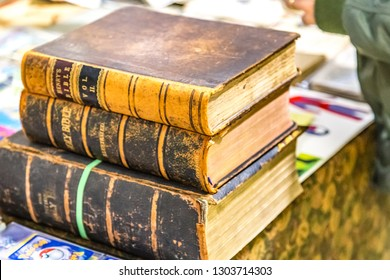 CESENA, ITALY - NOVEMBER 18, 2018: lights are enlightening old Holy Bible books for sale in Antiques Fair