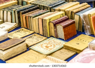 CESENA, ITALY - NOVEMBER 18, 2018: lights are enlightening old books for sale in Antiques Fair