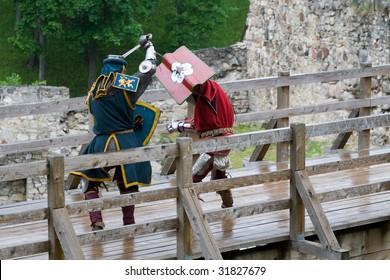 CESIS, LATVIA, June 7: Knight sword fight on wooden bridge during  the medieval festival Livonia. 1378. Held in Cesis, Latvia on June 7, 2009