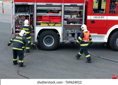 Ceska Lipa, Czech Republic - May 28, 2011: Czech firefighters and fire truck  working after a car crash collision.