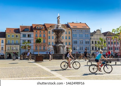 CESKE BUDEJOVICE, CZECH REPUBLIC - 24 JULY, 2019: Central town square with Samson fountain sculpture and girls on bikes in Ceske Budejovice.