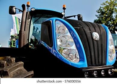 CESKE BUDEJOVICE, CZECH REPUBLIC - August 27, 2015: Detail of blue New Holland tractor bonnet, brand new machine