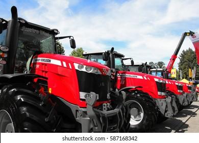 CESKE BUDEJOVICE, CZECH REPUBLIC - August 27, 2015: Massey Ferguson tractors in row on blue sky background