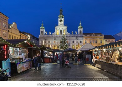 CESKE BUDEJOVICE, CZECH REPUBLIC - DECEMBER 8, 2017: Christmas market at the Premysl Otakar II Square with city's main Christmas tree on the background of the old Town Hall in twilight.