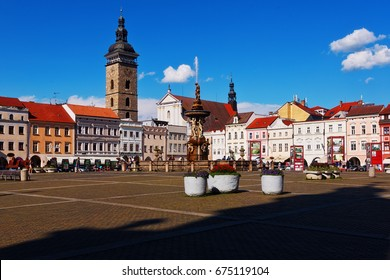 CESKE BUDEJOVICE, CZECH REPUBLIC - JULY 05, 2016: Central town square with Samson fighting the lion fountain sculpture and bell tower