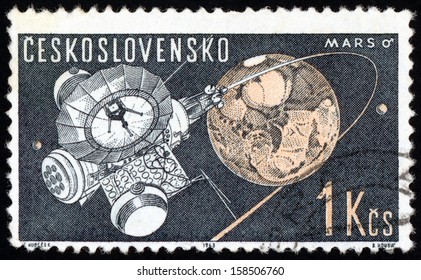CESKOSLOVENSKO - CIRCA 1963: stamp printed in Czech (Czechoslovakia) shows interplanetary station & Mars from space research exhibit Prague series, Scott 1172 A448 1k gray blue orange, circa 1963