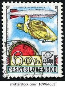 CESKOSLOVENSKO - CIRCA 1977: stamp printed in Czechoslovakia shows rigid airship Zeppelin 1909 & Graf 1928 LZ 127; PRAGA 1978 Emblem; History of aviation; Scott C89 AP24 60h yellow blue, circa 1977
