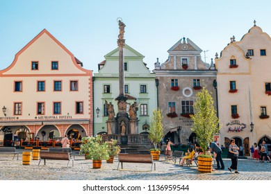 Cesky Krumlov, Czech - August 28, 2016 : Fountain and Plague Column and old buildings at Namesti Svornosti main square