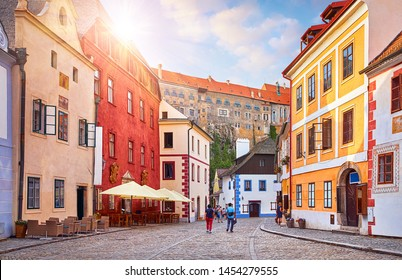 Cesky Krumlov, Czech Republic. Ancient street with old houses. Evening sunset with sunlight.