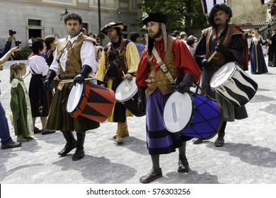 CESKY KRUMLOV, CZECH REPUBLIC - JUNE 22, 2014: Drummers dressed in historical costumes are walking in Krumlov streets during annual Five-Petalled Rose Celebrations.