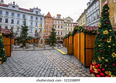 Cesky Krumlov square decorated with Christmas trees and installations for Christmas time, Czech Republic