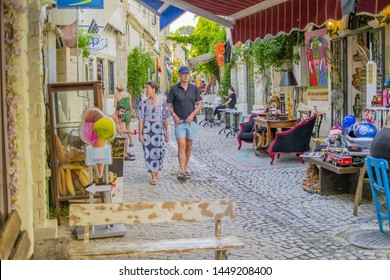 Cesme, Izmir / TURKEY - July 09 2019 :  People is walking in the Street of Alacati
