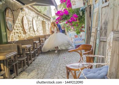 Cesme, Izmir / TURKEY - July 09 2019 : Bride and groom takes wedding photos in Alacati