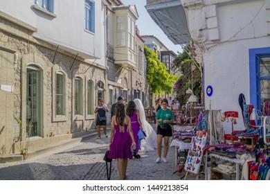 Cesme, Izmir / TURKEY - July 09 2019 : Street sellers in Alacati and people walking